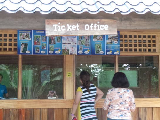 the ticket office..oops I can see my reflection. what is he doing there?