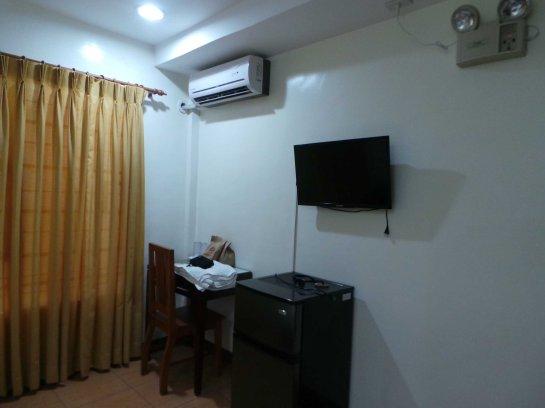 AC, study table, fridge and TV