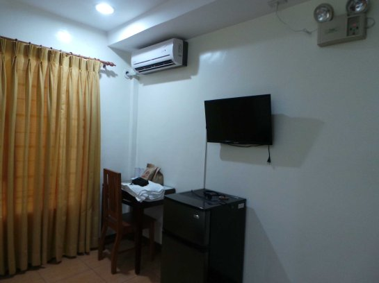 AC, study table, fridge and TV